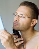 Shaving man — Stock Photo