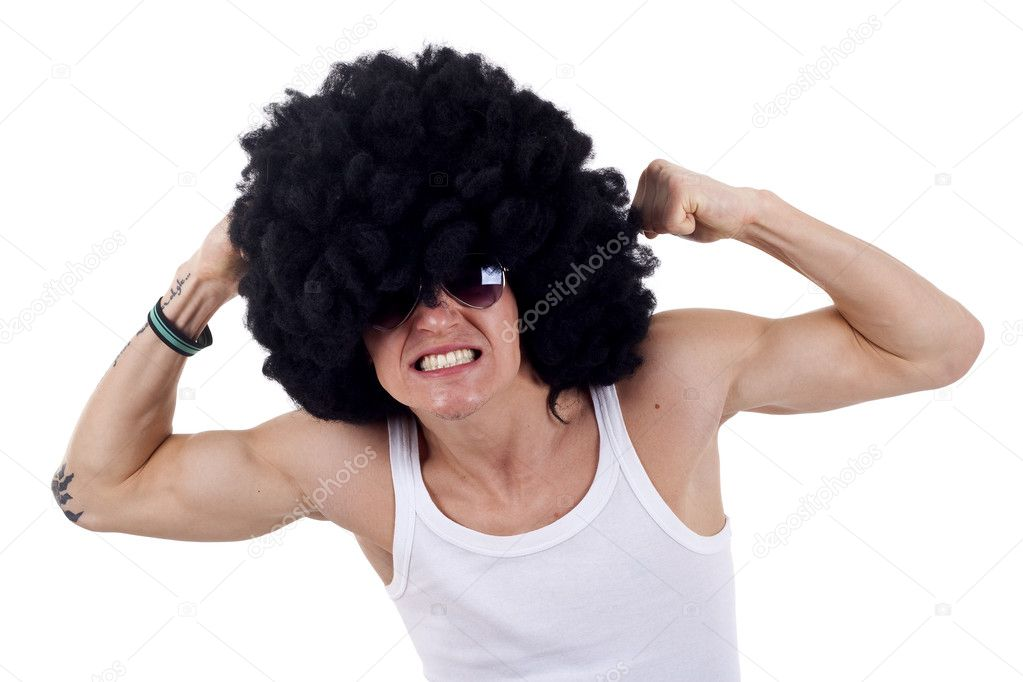 Young funky man flexing his muscles on a white background
