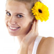Woman with flower in her hair — Stock Photo #3080231