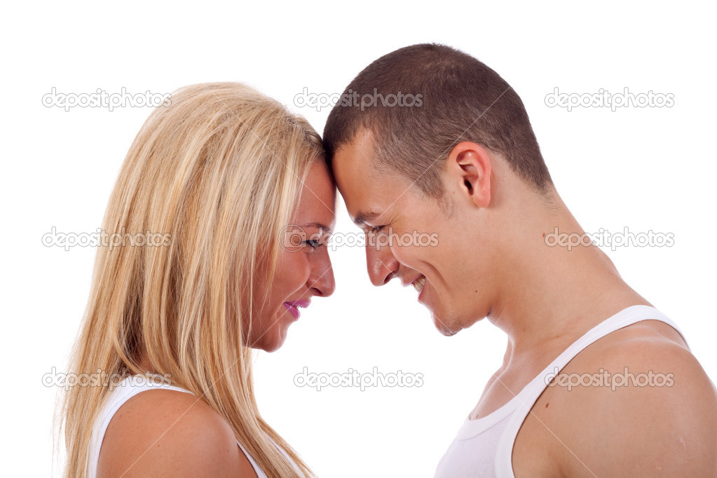 Closeup profile image of happy young couple looking face to face at eachother   Stock Photo #3363701