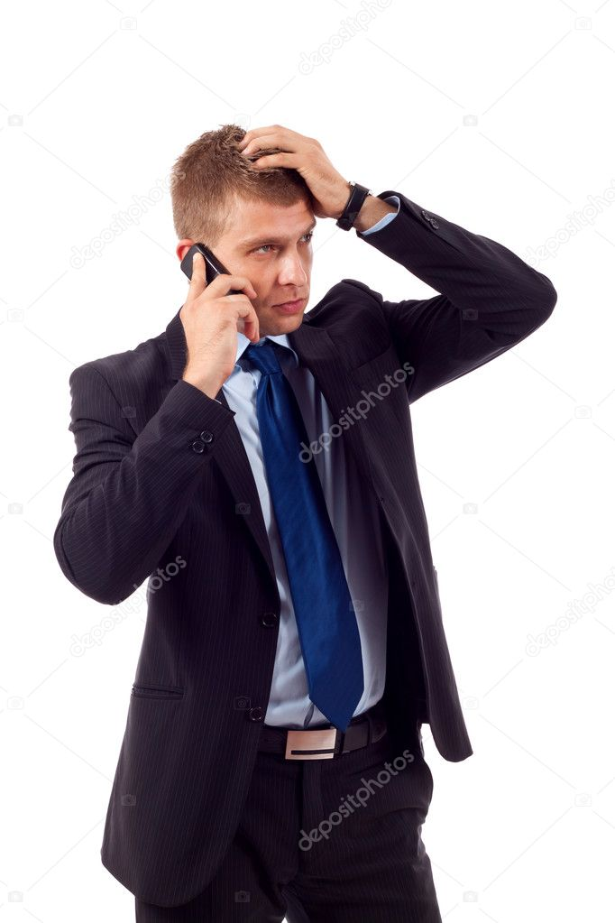 Businessman on the phone with hand on his head, receiving bad news — Stock Photo #3363775