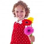 Little girl offering flowers — Stock Photo