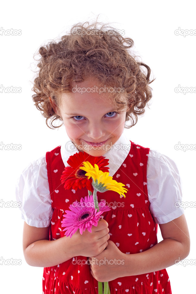 Cheerful little girl holding bunch of Gerabra flowers  — Stock Photo #3736298