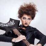 Attractive woman guitarist — Stock Photo