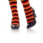 Feet wearing colored socks in high heels — Stock Photo