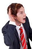 Young businessman listening — Stock Photo
