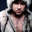 Royalty-Free Stock Photo: Portrait fashion men in fur