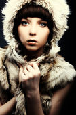 Fashion beautiful women brunette in fur — Stock Photo