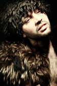 Portrait fashion men in fur — Stock Photo