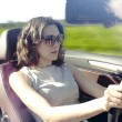 Young woman is driving — Stock Photo