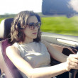 Young woman is driving — Stock Photo #3274495