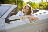 Woman is sitting in a car — Stock Photo