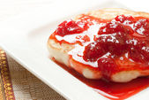 Pancake with strawberry syrup — Stock Photo