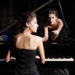 Woman playing piano — Stock Photo #2708877