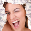 Stock Photo: Attractive woman takes 100 dollar bills