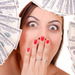 Attractive woman takes 100 dollar bills — Stock Photo
