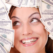 Attractive woman takes 100 dollar bills — Stock Photo #2711199