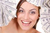 Attractive woman takes 100 dollar bills — Stock Photo