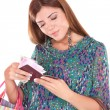 Excited traveler with her passport - Stockfoto