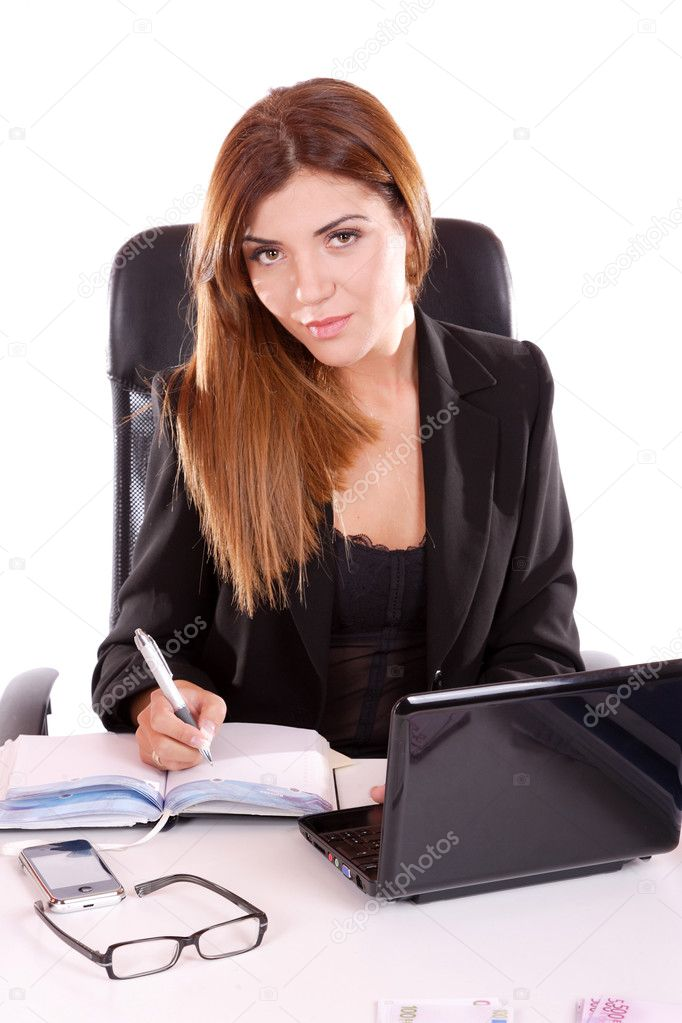 Portrait of a young attractive business woman writting — Stock Photo #2721573