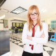 Young Attractive blond Receptionist - Stock Photo