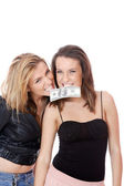 Isolated two women with money — Stock Photo