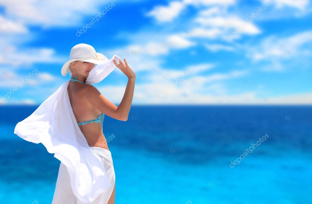 Beautiful young woman relaxing by the beach in Greece  Stock Photo #2824188