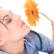 Beautiful woman face with sunflower — Stock Photo