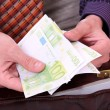 Stockfoto: Mis paying with euro banknotes