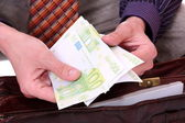 Man is paying with euro banknotes — Stockfoto
