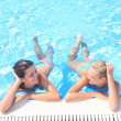 Enjoying the sun in a swimming pool - Stock Photo