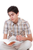 Handsome young man reading a book — Stock Photo