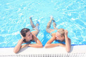 Enjoying the sun in a swimming pool — Stock Photo