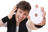 Young guy holding a compact disc — Stock Photo