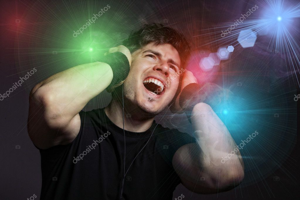 Young Man listening to music with headphones on dark background — Stock Photo #2913847