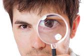 Curious man examining — Stock Photo