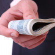 Money in a businessman hands - Stock Photo
