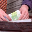 Man is paying with euro banknotes — Stock Photo