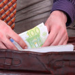 Man is paying with euro banknotes - Photo