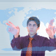 Royalty-Free Stock Photo: Businessman touching a on a world map