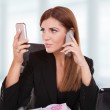 Young business woman with phone — Stock Photo #3008806