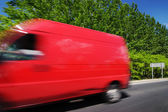 Transportation with red van — Stock Photo