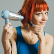 Woman with hairdryer and a hairbrush — Stock Photo #2858978
