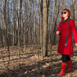Beautiful girl wearing red coat and sunglasses — Stock Photo #2902241