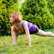 Stock Photo: Beautiful red woman doing fitness or yoga exerci