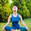 Beautiful red woman practicing meditation — Foto Stock