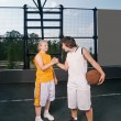 Two teenage players with basketball — Stock Photo