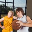 Two teenage players with basketball - Stockfoto