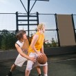 Teenagers playing basketball — Stock Photo #3521901