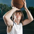 Stock Photo: Streetball player shooting basketball